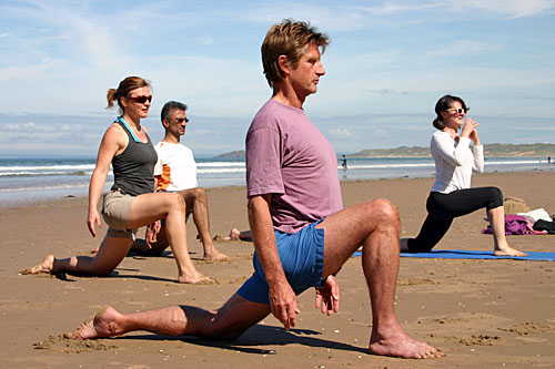 yoga teacher training course being taught on a beach